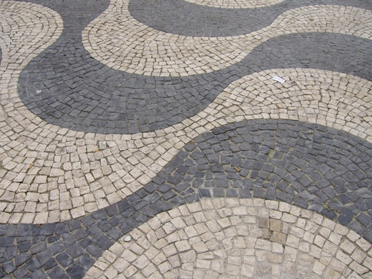 Cobblestone street in grey and tan serpentine pattern