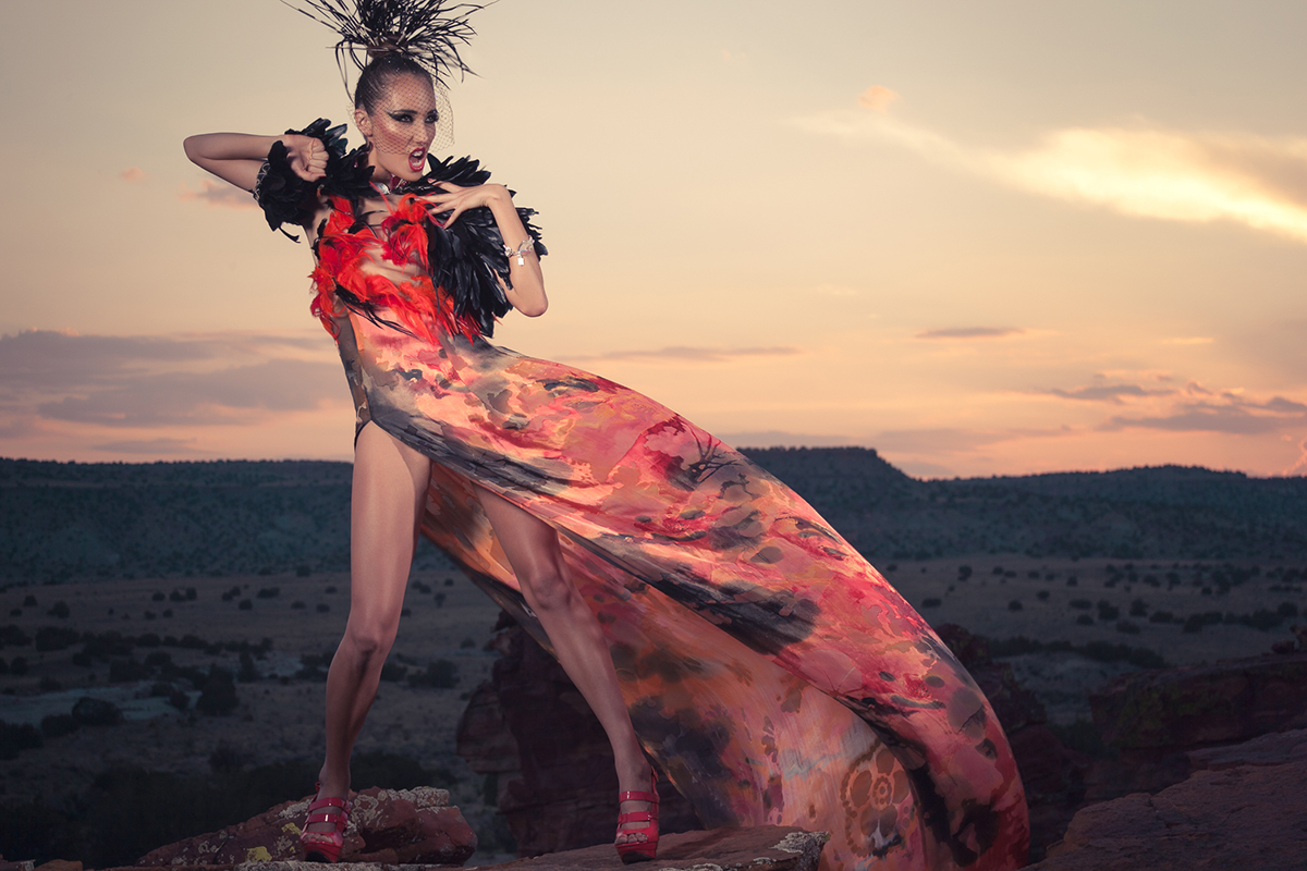"""Orlando Dugi (Diné [Navajo]) Cape, dress, and headdress from """"Desert Heat"""" Collection, 2012 Paint, silk, organza, feathers, beads, and 24k gold; feathers; porcupine quills and feathers Courtesy of the designer, Santa Fe. Hair and Makeup: Dina DeVore. Model: Julia Foster. Photo by Unék Francis."""