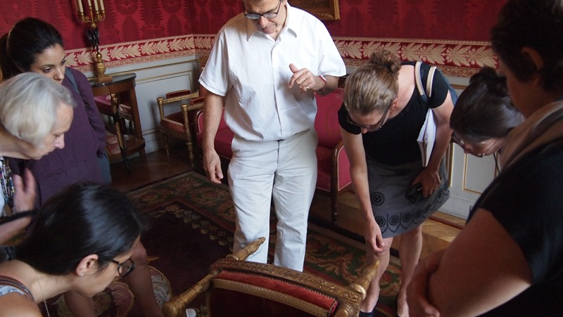 Students examine Parisian interiors and furnishings with Dr. Ulrich Leben.