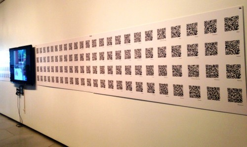 """QR codes span across a wall in """"Furnishing the Cloud."""""""