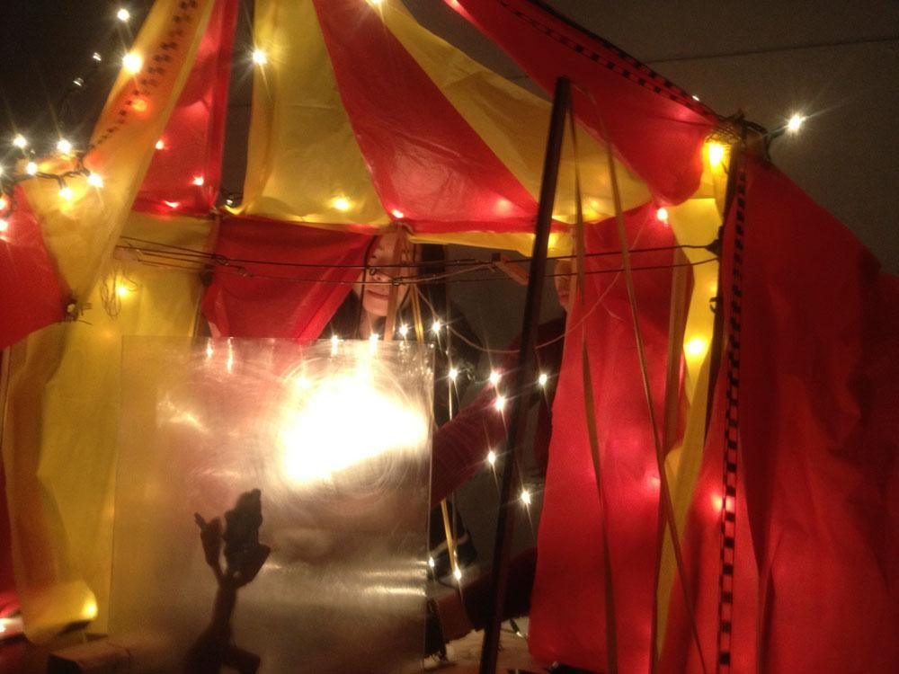 Studio students prepare for characters' live performances beneath the big tent.